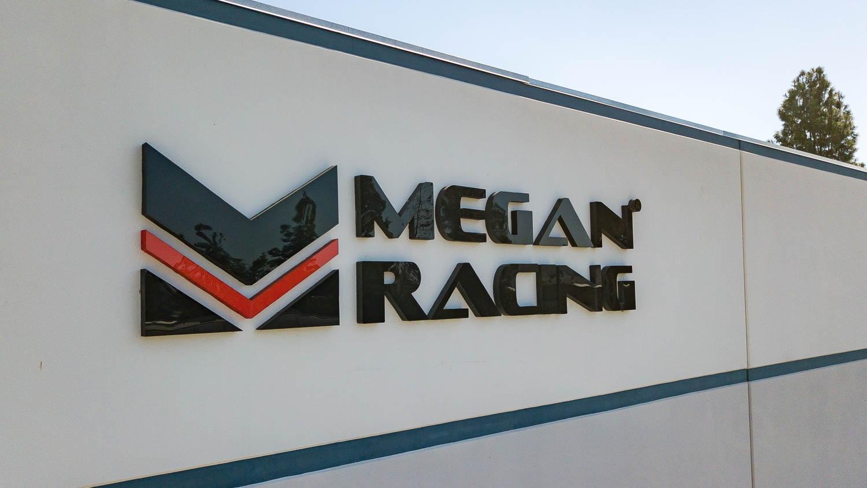Megan Racing Building Logo